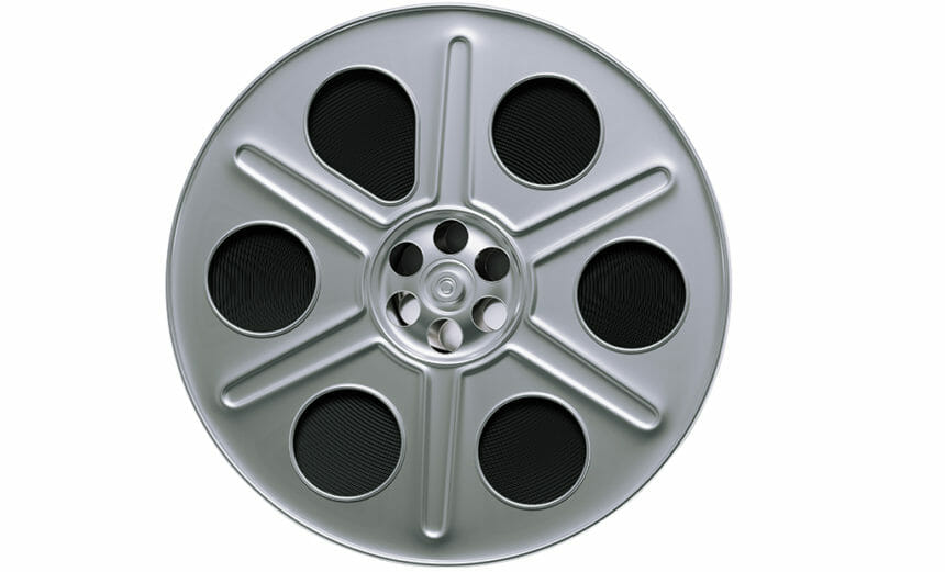 Film reel on white background. Horizontal composition with clipping path and copy space.