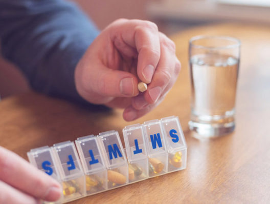 How can improved medication adherence promote value-based care?